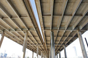 photo - Steel beams supporting the deck of the elevated Interstate 40 Crosstown, such as these near Bass Pro Drive in downtown Oklahoma City, will be salvaged and made available to county bridge projects across the state.<br /> <strong>PAUL B. SOUTHERLAND - THE OKLAHOMAN</strong>