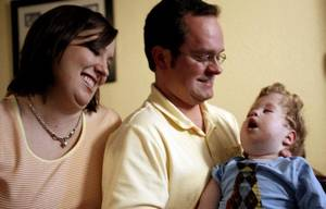 photo - Steven and Cindy Bergren pose for a portrait in 2009 with their son Levi who suffered from Hydranencephaly. Levi died Sept. 10, 2010 at age 3. <strong>SARAH PHIPPS - THE OKLAHOMAN</strong>