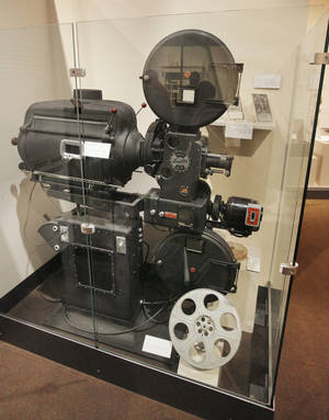 A 1930s movie projector from the Jewel Theater is on display at the Oklahoma History Center.